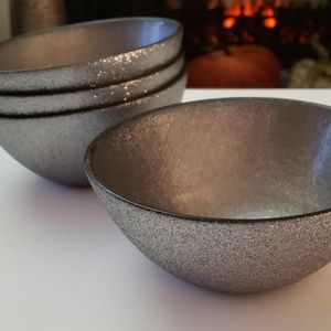 Four silver bowls